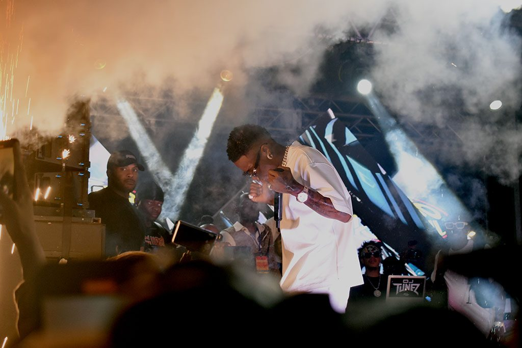 As the smoke clears, WizKid is played off to a screaming crowd.