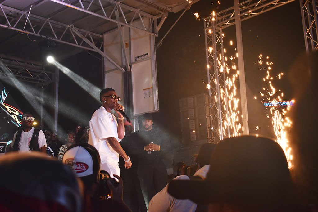 """Sparks fly as WizKid performs hits like """"Essence"""" for an eager crowd."""